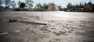 sealcoat to prevent asphalt cracking